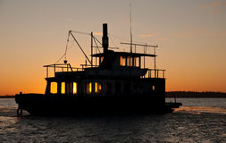 Boat. Old abandoned boat at sunset on a winter day Stock Photos