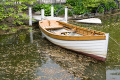 Boat. A wooden boat by a lake in a park Royalty Free Stock Photography