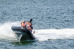 HOLIDAY AT THE SEASIDE. KOLOBRZEG., WEST POMERANIAN / POLAND - 2019: A crazy tourist ride by motorboat in the sea royalty free stock photos