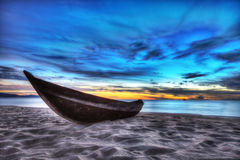 Boat. Old fisherman boat at sunrise time on the beach Stock Photo