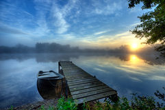 Boat. At a small pier at sunrise and light fog Royalty Free Stock Images