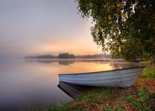 Boat. Early morning by a lake with a boat Stock Photos