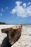 Boat. Local wooden Fishing boat on a beach on the east coast of Zanzibar Royalty Free Stock Photo