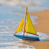 Boat. Little toy boat in the sea waves Royalty Free Stock Photos