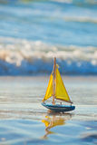 Boat. Little toy boat in the sea waves Royalty Free Stock Photography