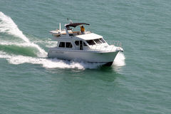 Boat. Cabin cruiser boat on lake michigan in spring royalty free stock images