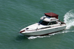 Boat. Cabin cruiser boat on lake michigan in spring stock images