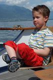 On the boat. Young boy at a boat Royalty Free Stock Photography