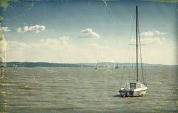 Boat. Vintage style photo. Sailing boat on lake Royalty Free Stock Photography