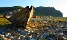 Boat. Coast broken landscape old stones Royalty Free Stock Image