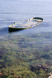 Boat. Old wooden boat sinking in the sea royalty free stock images