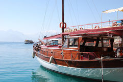 Boat. Sailing boat at a mooring on a background of a beautiful bay Royalty Free Stock Images