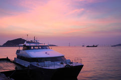Boat. In harbour with pink sunset Stock Images