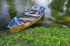 Boat. At pond bank in summer park stock photography