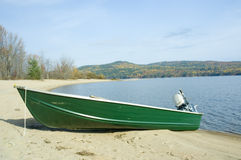 Boat. A small green boat near the shore stock images