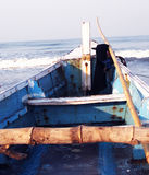 In The Boat. A old rusty blue boat in the sea Stock Images