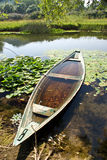 Boat. Old boat by the lake, green rural landscape, countryside of Montenegro Royalty Free Stock Photo