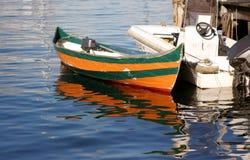 Boat. Orange-Green boat Royalty Free Stock Photo