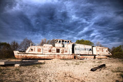 Boat. The old ship ashore, dramatic Royalty Free Stock Photography