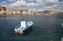 Boat. On output from bay, island Symi, mediterranean sea stock images
