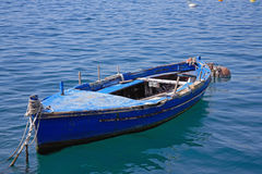 Boat. Blue boat on blue water Stock Photo