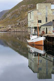 Boat in the abandoned harbour of Nyksund Stock Photo