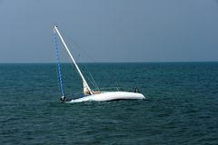 Boat adrift on Adriatic Sea. A sailboat adrift on the Adriatic Sea in Italy royalty free stock photos