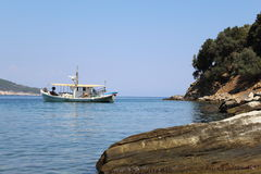 Boat on Aegean Sea. Boat on AegeanSea where water is super crystal Royalty Free Stock Photo