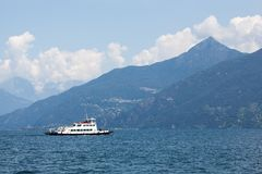 Boat against mountains on Lake Como Stock Image