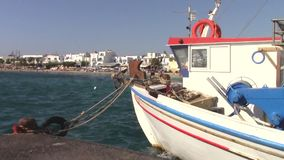 Boat in  Agia Anna village in Naxos island. Old fishing boat in Agia Anna village in Naxos island from the sea stock video footage