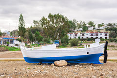 The boat are aground in shallow sea water. Ship run aground in waterless pier or harbor. Stock Images
