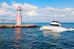Boat by Algoma Pierhead Lighthouse Stock Photo