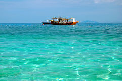 Boat alone. Boat and clear water ocean stock photos