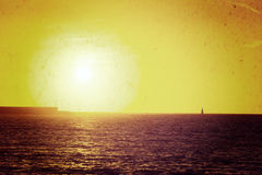 Boat alone in the sea at sunset in vintage tone Stock Photography