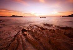 Boat alone in sea twilight Stock Image
