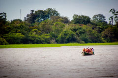 A boat in the amazon river jungle lagoon Royalty Free Stock Photography