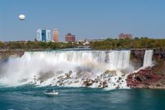 Boat and American Falls from Niagara Falls - Ontario, Canada royalty free stock photography