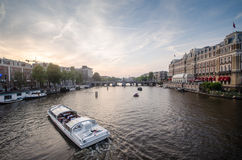 Boat in Amstel river in Amsterdam Stock Photography