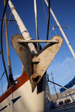 Boat anchor on the bow. Bow of a sailboat with an anchor stock photography