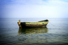 Boat at anchor in sea high contrasted Stock Photography