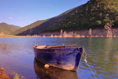 Boat anchored on Kozjak lake Stock Photo