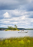 Boat anchored on lake Stock Photos
