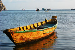 Boat anchored near the shore Stock Images