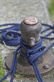 Boat anchored pole. With blue rope, England Royalty Free Stock Photos