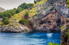 Boat anchored at Sa Calobra Royalty Free Stock Photos