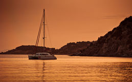 Boat anchored in sunset Royalty Free Stock Images