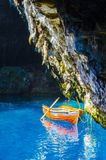 The boat on ancor on the Melissai lake near the cave royalty free stock images