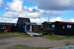 Free Boat And Fishermens Huts In Southwold Harbour, Suffolk, UK Stock Photography - 162410532