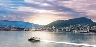 Boat approaching the coast of Bergen stock photography