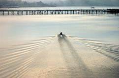 A boat approaching Mon bridge in Sangkhlaburi Royalty Free Stock Photography
